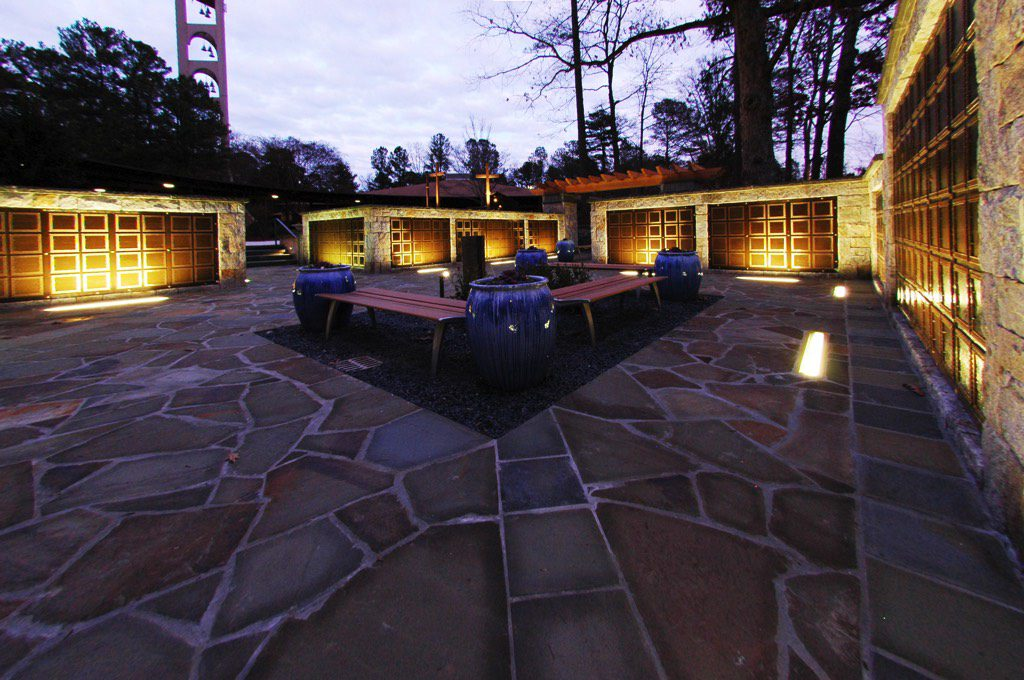 All Saints Catholic Church Columbarium Benches and Planters at Dusk with Lights